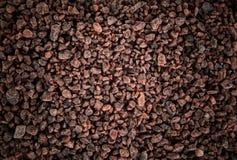 Dark brown coarse grain salt heap texture. Top view Royalty Free Stock Images