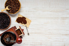 Dark and Brown Coffee Beans with Grinder on Copy Space Stock Image