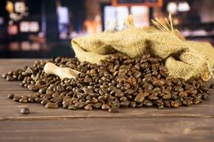 Dark brown coffee beans sweet arabica with restaurant stock photos