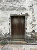 Dark brown door on white wall background. Dark brown door or white wall background wallpaper Stock Photos