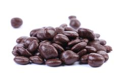 Dark brown dragee, in chocolate covered. Royalty Free Stock Photography