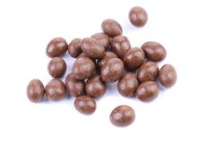 Dark brown dragee, in chocolate covered. Royalty Free Stock Photos