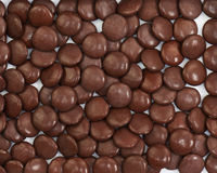 Dark brown dragee in chocolate covered. Royalty Free Stock Images
