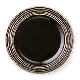 Dark brown empty ceramic plate, top view of an isolated stock image