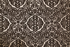 Dark brown flock wallpaper pattern Stock Photography