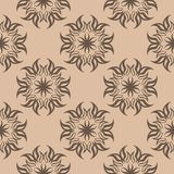 Dark brown floral seamless pattern on beige background. Dark brown floral ornament on beige background. Seamless pattern for textile and wallpapers Royalty Free Stock Images