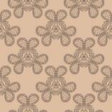 Dark brown floral seamless pattern on beige background. Dark brown floral ornament on beige background. Seamless pattern for textile and wallpapers Stock Image