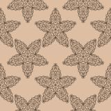 Dark brown floral seamless pattern on beige background. Dark brown floral ornament on beige background. Seamless pattern for textile and wallpapers Royalty Free Stock Photography