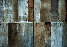 Dark brown and gnarly wooden background Royalty Free Stock Photography