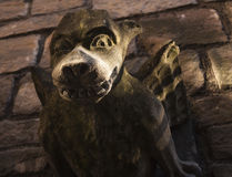 Dark brown and green gargoyle Stock Photo