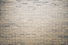 Dark brown grunge brick wall texture background Stock Images