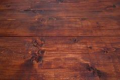 Dark brown inclined wood background. Dark orange-brown inclined wood board Stock Photography