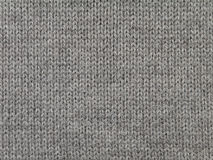 Dark brown knitted wool fabric. Cool weather background Royalty Free Stock Photo