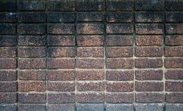 Dark brown laterite stone wall Stock Photography