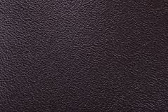 Dark brown leather. Dark brown cattle leather texture Stock Photography