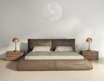 Dark brown leather bed in contemporary chic interior Royalty Free Stock Images