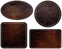 Dark brown leather labels on white background isolated. Stitching on edges. Stock Images