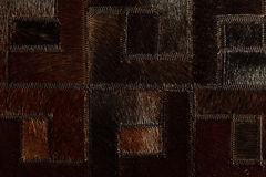 Dark brown leather patchwork. Dark brown real leather patchwork Royalty Free Stock Images
