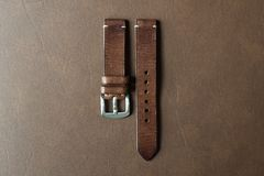 Free Dark Brown Leather Watch Strap With Stainless Buckle On Leather Background, Craft And Handmade Watch Bracelet. Stock Photos - 155705703