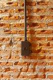 Dark brown light switches on brick wall Stock Image