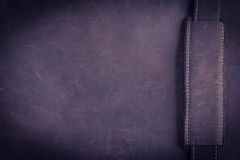 The dark brown Nubuck leather background and texture with gold s Stock Photo