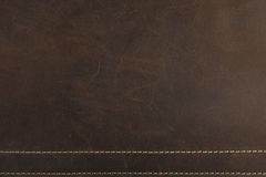 The dark brown Nubuck leather background and texture Royalty Free Stock Photography