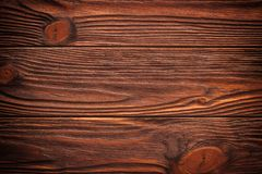 Dark brown old grungy wooden wall, background photo texture. Old brown wooden wall, detailed background photo texture. Wood plank fence close up stock images