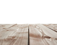 Dark brown paint coated wooden boards. Dark brown paint coated wooden pine boards as a copyspace background composition isolated over the white background Royalty Free Stock Image