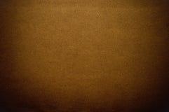 Dark brown paper. Grainy brown paper in dark tone Stock Images