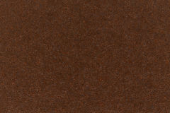 Dark brown paper texture cardboard background. High resolution photo Royalty Free Stock Photography