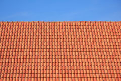 Dark brown roof against blue sky Stock Photography