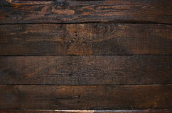 Dark brown rustic  aged barn wood planks background. Space for text, copy, lettering Royalty Free Stock Image