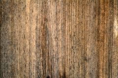 Dark brown scratched wooden cutting board. Wood texture. Dark brown scratched wooden cutting board. Wood texture royalty free stock photo