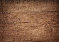 Dark brown scratched wooden cutting board. Wood Stock Photos