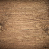 Dark brown scratched wooden cutting board. Wood Stock Image