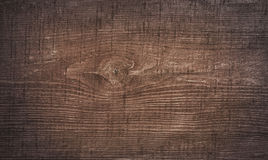 Dark brown scratched wooden cutting board. Wood texture Royalty Free Stock Images