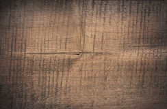 Dark brown scratched wooden cutting board. Wood texture Royalty Free Stock Photography