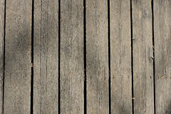 Dark, brown, scratched wooden cutting board. Wood texture. Royalty Free Stock Photo
