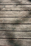 Dark, brown, scratched wooden cutting board. Wood texture. Stock Photography