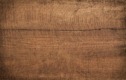 Dark brown scratched wooden cutting board. Wood texture Royalty Free Stock Photo