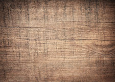 Dark brown scratched wooden cutting board. Wood texture Stock Images