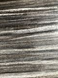 Dark brown scratched wooden cutting board. Wood texture stock photography
