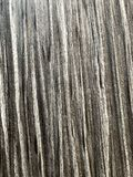 Dark brown scratched wooden cutting board. Wood texture stock image
