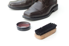 Dark brown shoe with shoe polish and brush shoe Royalty Free Stock Image