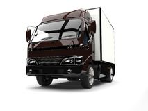 Dark brown small box truck - low angle shot. Isolated on white background Royalty Free Stock Image