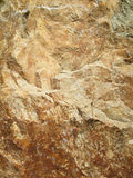 Dark brown stone with cracks on the surface Stock Photo