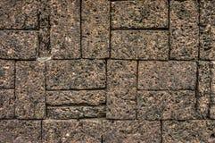 Dark brown stone wall Stock Photos