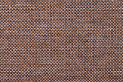 Dark brown textile background with checkered pattern, closeup. Structure of the fabric macro. Royalty Free Stock Photography