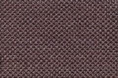 Dark brown textile background with checkered pattern, closeup. Structure of the fabric macro. Stock Images