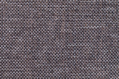 Dark brown textile background closeup. Structure of the fabric macro Royalty Free Stock Image